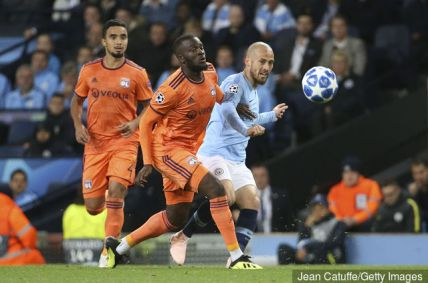 tanguy_ndombele_of_lyon_david_silva_of_manchester_city_during_th_915889